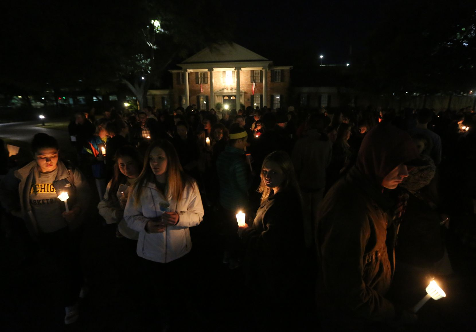"""Baylor students and alumni hold a candlelight vigil outside the home of Baylor University President Ken Starr, in what organizers call a Survivors Stand"""", Monday, Feb. 8, 2016, in Waco, Texas. The students and supporters attended the event in an effort to urge changes to how the school handles sexual assault. (Rod Aydelotte/Waco Tribune Herald, via AP)"""