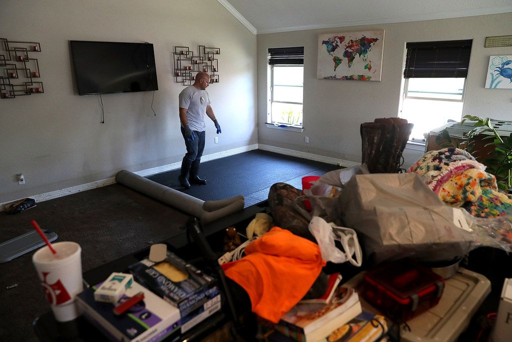 RICHWOOD, TX - SEPTEMBER 07:  Justin Davison stands in the living room of his friend's flood damaged home on September 7, 2017 in Richwood, Texas. Over a week after Hurricane Harvey hit Southern Texas, residents are beginning the long process of recovering from the storm.  (Photo by Justin Sullivan/Getty Images)