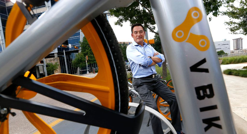 David Shan, president of VBikes, poses for a photograph with the units parked at Klyde Warren Park in Dallas, Tuesday, June 13, 2017. (Jae S. Lee/The Dallas Morning News)