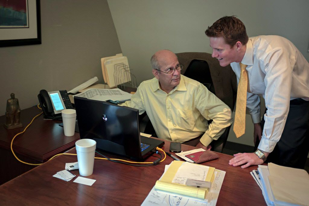 Lewis Wood (left), president of multifamily investments for Henry S. Miller Realty, chatted with associate Andrew Doster in 2013 at the company's offices in North Dallas.
