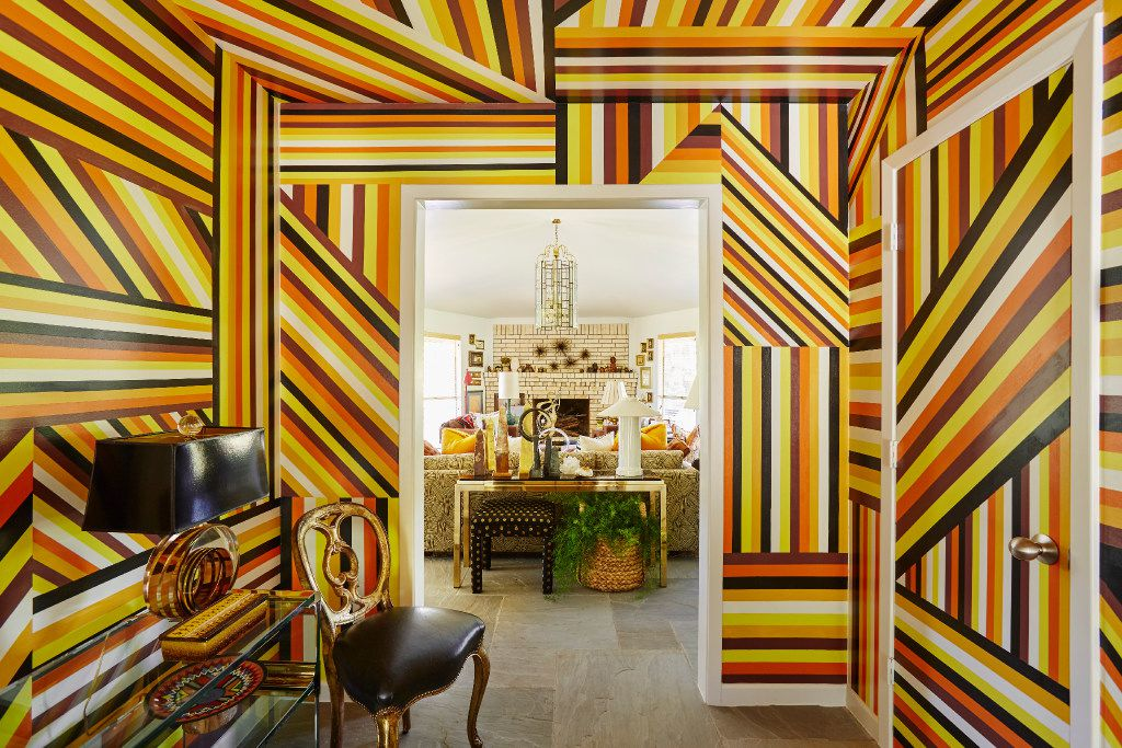 """Nathan Green was commissioned to create the mural, """"CEPRD Retrofit (For Ken and Sam)"""" in the hallway of the Cedar Creek lake house of Neiman Marcus executive Ken Downing and his partner, real estate agent, Sam Saladino.  The piece took nearly 190 hours to complete. """"There is nothing more irreverent,"""" Downing says, """"than having an artist create something right on the drywall. Every time I walk through the hallway, it just makes me smile."""" (Stephen Karlisch/Special Contributor)"""