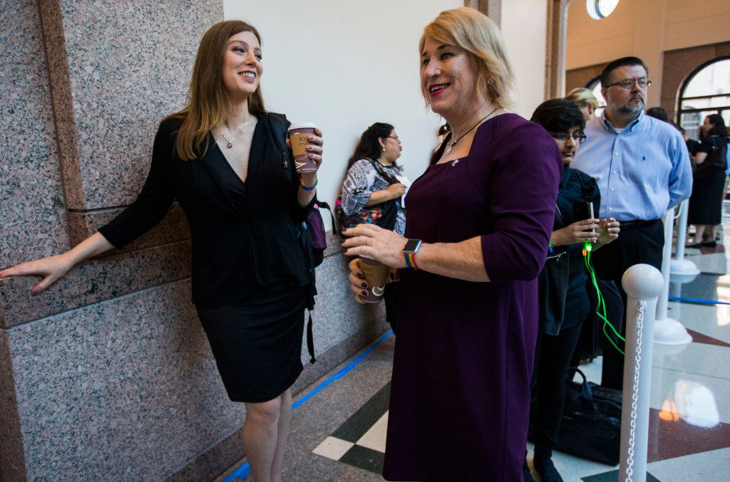 Ashley Smith (left) and New Hope Mayor Jess Herbst, who are both transgender, stand at the front of the line to voice their opinions on the bathroom bill at a public hearing on the fourth day of a special legislative session last July in Austin.