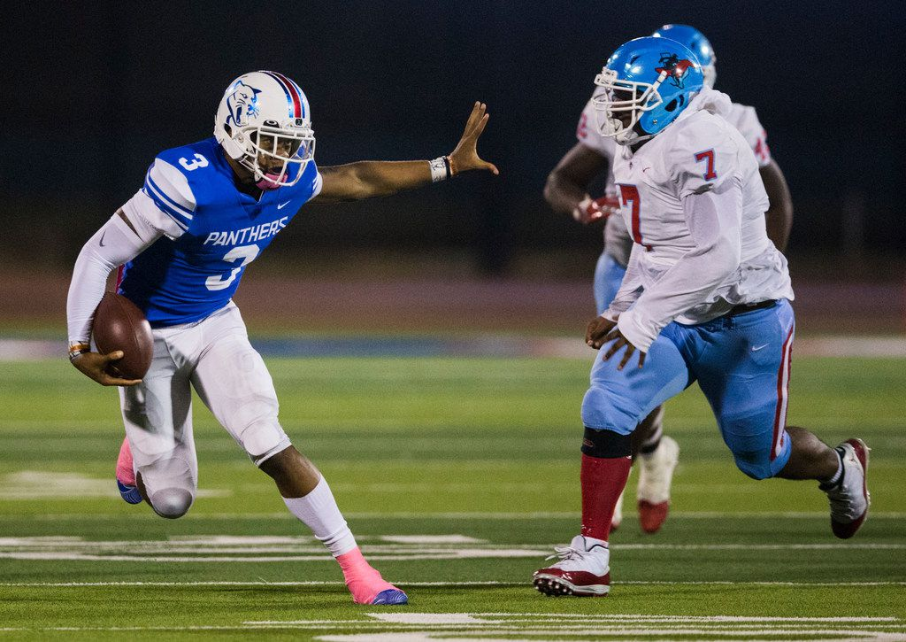 Duncanville quarterback Ja'Quinden (3) runs the ball against Skyline defensive lineman Jason Lara (7) during the second quarter of a high school football game between Skyline and Duncanville on Friday, October 4, 2019 at Panther Stadium in Duncanville. (Ashley Landis/The Dallas Morning News)
