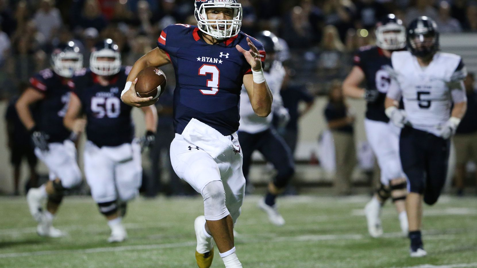 Denton Ryan quarterback Spencer Sanders (3) rushes with the ball in the third quarter during a high school football game between Frisco Lone Star and Denton Ryan at C. H. Collins Athletic Complex in Denton, Texas Friday September 16, 2016. Denton Ryan beat Frisco Lone Star 51-34. (Andy Jacobsohn/The Dallas Morning News)