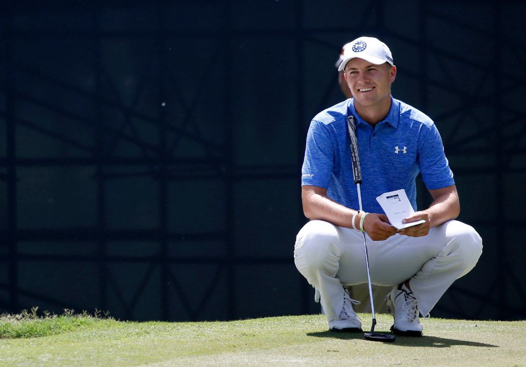 Jordan Spieth smiles as he waits to putt on the 8th hole during Round One of the Dean & DeLuca Invitational at Colonial Country Club in Fort Worth on Thursday, May 25, 2017. (Vernon Bryant/The Dallas Morning News)
