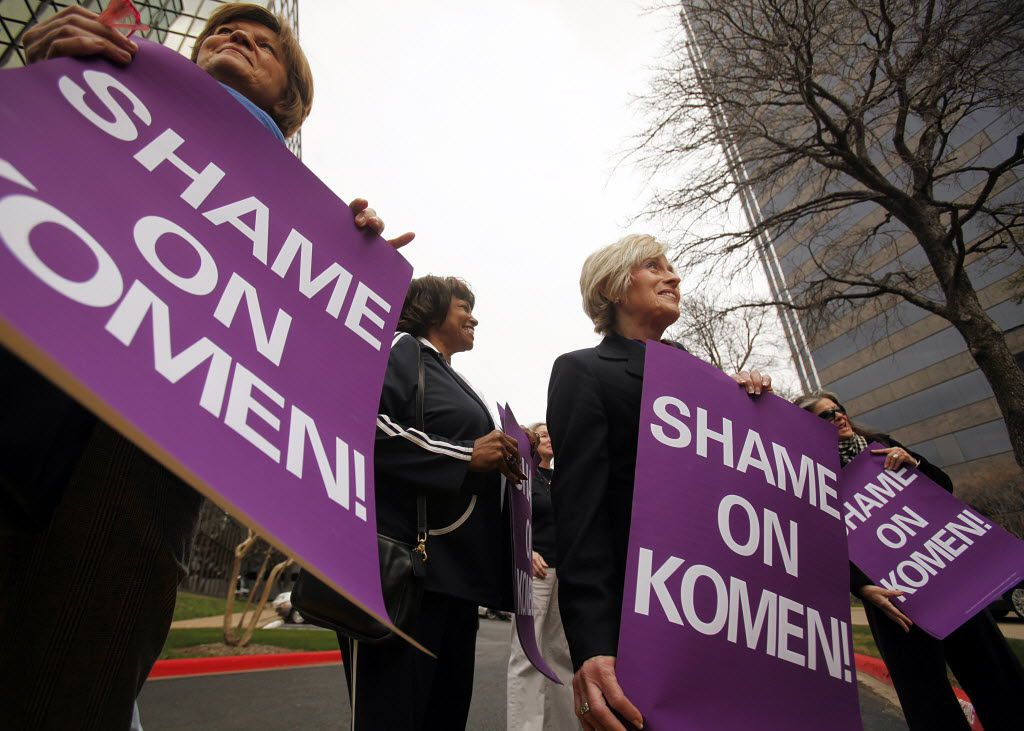 MoveON.org members (from left) Regine Rudler of Dallas, Clara Faulkner, and Tina Penney of Bedford protest outside the Susan G. Komen for the Cure headquarters, Tuesday, February 7, 2012, in Farmers Branch, demanding continued funding of Planned Parenthood.  The group delivered petitions with 832,00 signatures to Komen officials.  (Tom Fox/The Dallas Morning News)