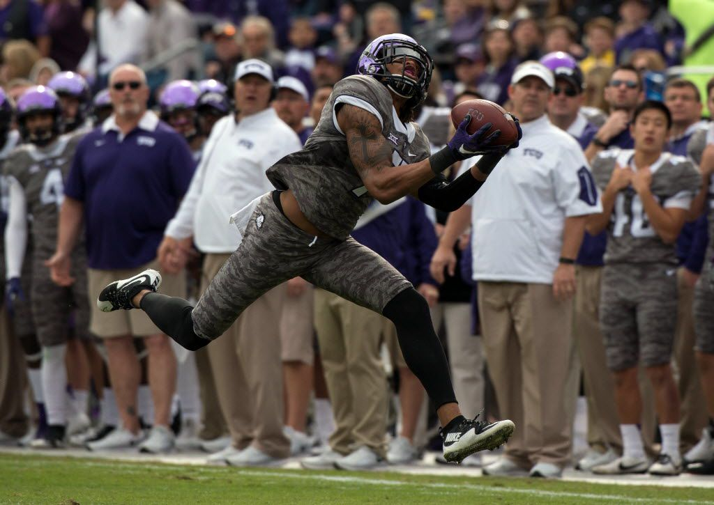 Nov 14, 2015; Fort Worth, TX, USA; TCU Horned Frogs wide receiver Kolby Listenbee (7) catches a pass for a first down against the Kansas Jayhawks during the first quarter at Amon G. Carter Stadium. Mandatory Credit: Jerome Miron-USA TODAY Sports