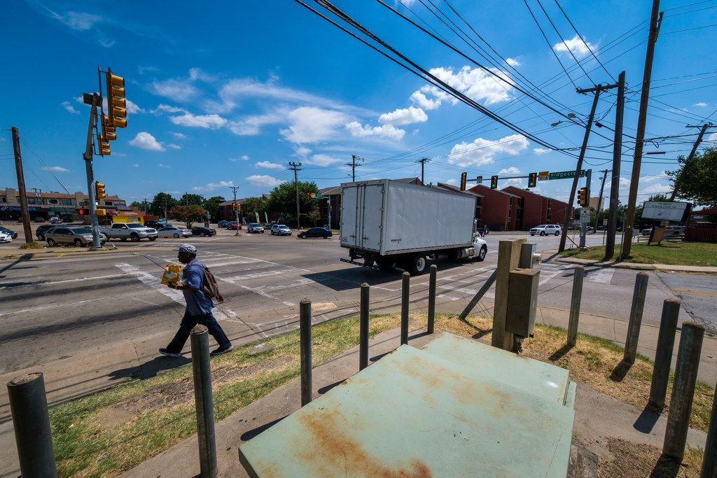 Traffic passes through the intersection where Park Lane, Ridgecrest Road and Fair Oaks Avenue all converge in Vickery Meadow, known as Five Points, one of northeast Dallas' most dangerous neighborhoods.