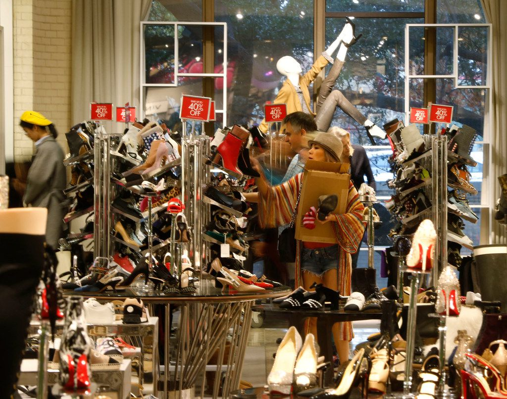 Teecy Mai shops for shoes at Neiman Marcus in the NorthPark Center in Dallas on Nov. 23, 2018. (Nathan Hunsinger/The Dallas Morning News)