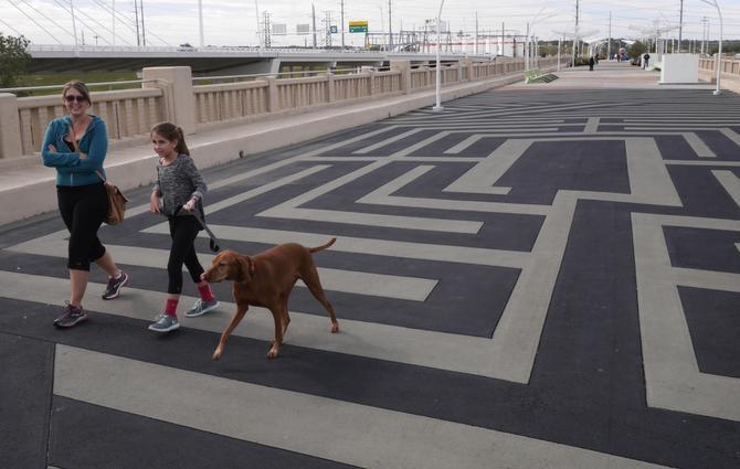 From left, Nicole Loper, Chelsea Loper, 10, and Copper walk across the Labyrinth on the Continental Avenue Bridge in Dallas Saturday November 8, 2014.