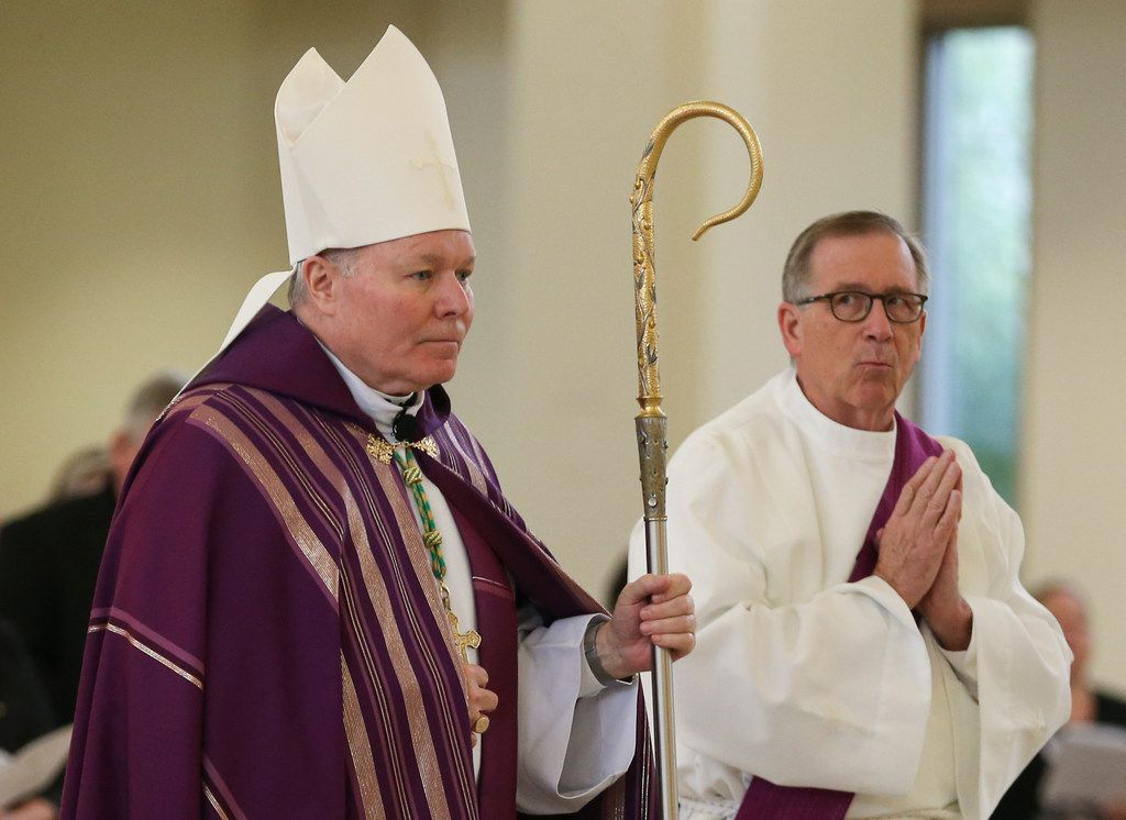 Bishop Edward J. Burns processes to the altar alongside Deacon John OÕLeary during a Ceremony of Sorrow on Tuesday, Oct. 9, 2018 at St. Cecilia Catholic Church in Dallas. Following the service, the first of four town halls was held to address the current crisis of sexual abuse by clergy, including allegations of sexual abuse by the former pastor of St. Cecilia Catholic Church, Reverend Edmundo Paredes. (Ryan Michalesko/The Dallas Morning News)