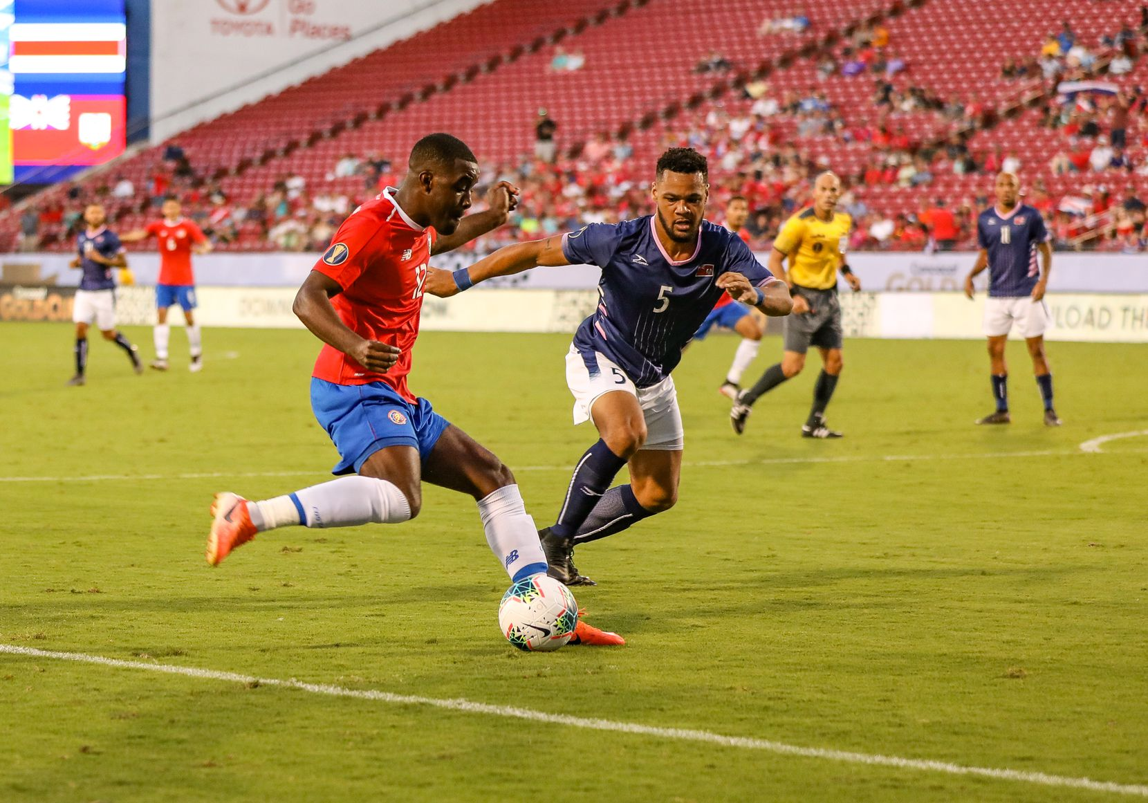 Joel Campbell cuts back against Bermuda defender Jalen Harvey at the 2019 Gold Cup at Toyota Stadium. (6-20-19)