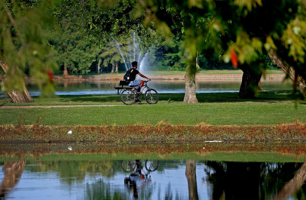 A man rides a bicycle at Towne Lake Recreation Area in McKinney.