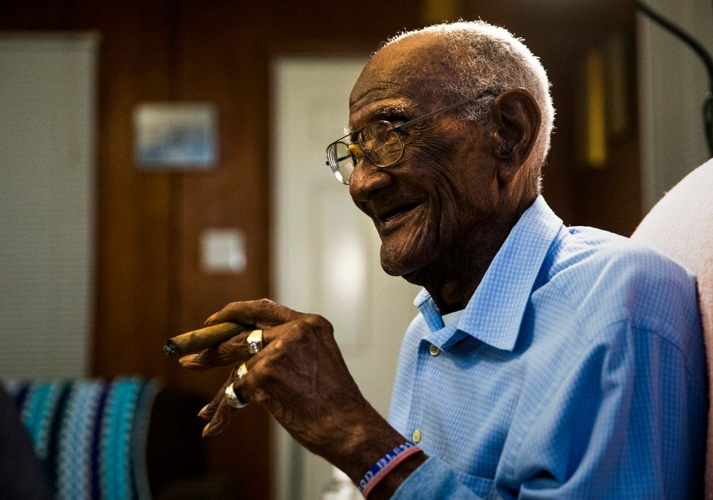 U.S. Army veteran Richard Overton, shown just before his 112th birthday, smokes one of his many daily cigars at his Austin home.