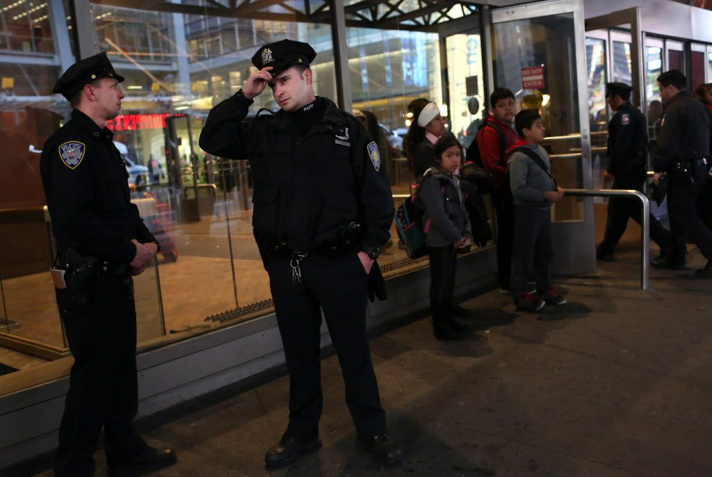 NEW YORK - NOVEMBER 26: Port Authority Police Officers patrol the area around the Port Authority Bus terminal on November 26, 2015 in New York City.