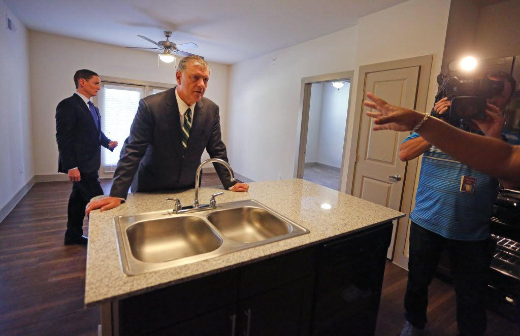 Dallas Mayor Mike Rawlings, center, and Dallas County Commissioner Clay Jenkins, left, check out one of the two-bedroom apartments during a tour of HighPoint Family Living, an affordable housing development in Oak Cliff on Thursday, August 25, 2016. (Louis DeLuca/The Dallas Morning News)