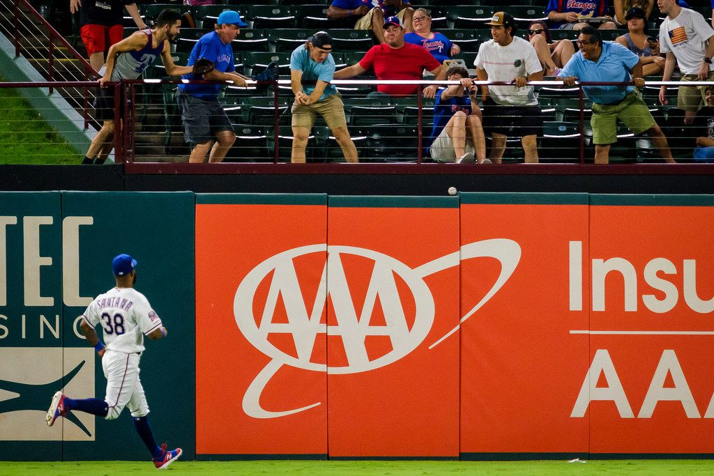Texas Rangers infielder Danny Santana (38) watches fans try to catch a 3-run home run off the of Tampa Bay Rays first baseman Ji-Man Choi to tie the game at 7-7 in the top of the second inning at Globe Life Park on Wednesday, Sept. 11, 2019, in Arlington. (Smiley N. Pool/The Dallas Morning News)