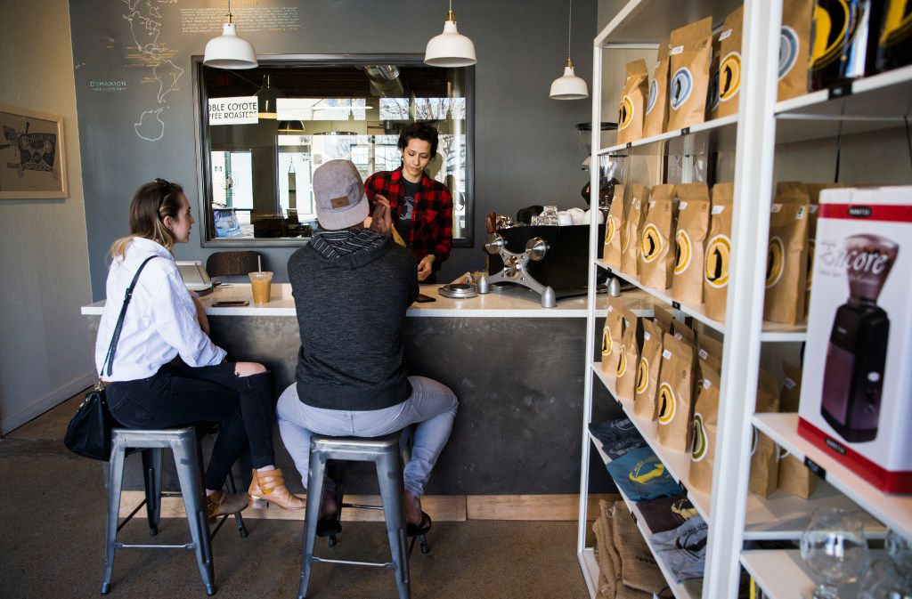 Bar manager Tiffany McAnarney serves coffee to customers at Noble Coyote Coffee Roasters across the street from Fair Park on Friday, January 20, 2017 on Exposition Avenue in Dallas.