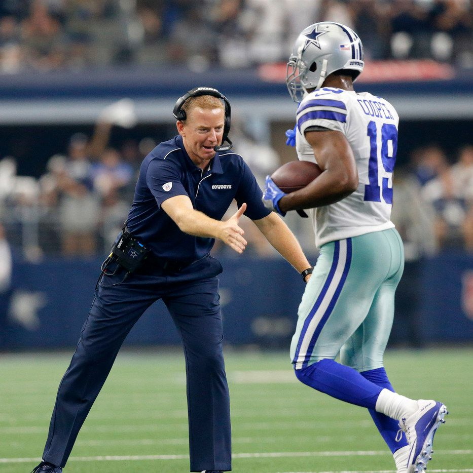 Dallas Cowboys head coach Jason Garrett congratulates wide receiver Amari Cooper (19) on his second quarter touchdown at AT&T Stadium in Arlington, Texas, Sunday, September 8, 2019.