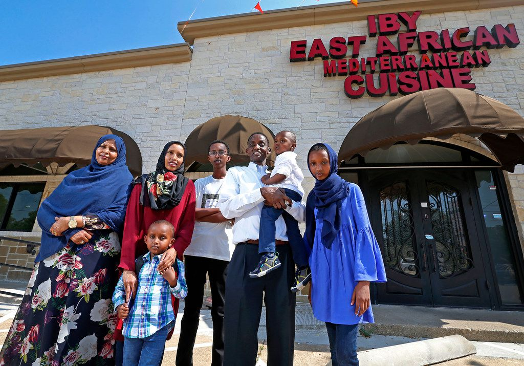 Abdulkadir Egal (second from right) holds his son Yusuf Egal, 2, in front of his restaurant Iby, with (from left to right) mother-in-law Khadija Farah, wife Asia Hersi, son Ibrahim Egal, 4, son Khalid Egal, 15, and daughter Rayann Egal, 12.