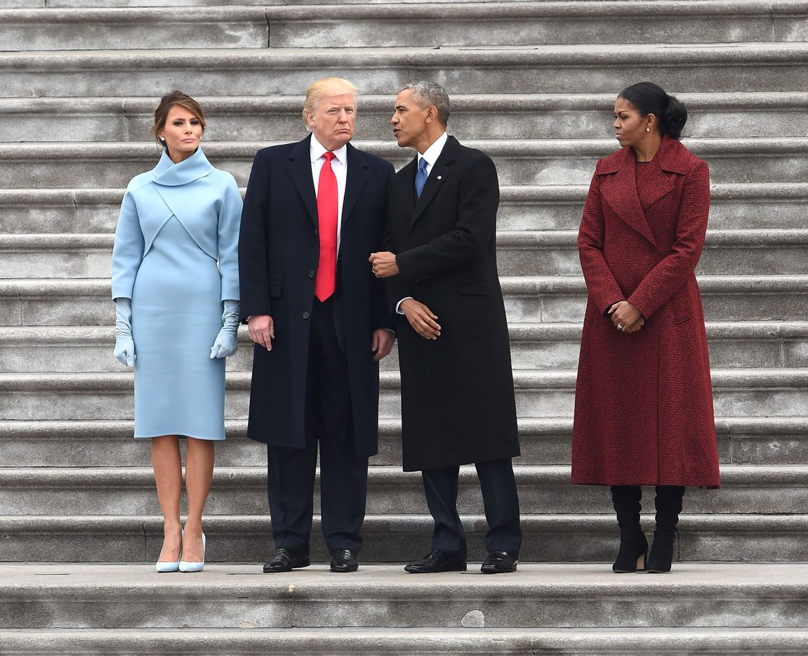 First Lady Melania Trump and President Donald Trump stand with former President Barack Obama and Michelle Obama after inauguration ceremonies at the US Capitol on January 20, 2017 in Washington, DC.