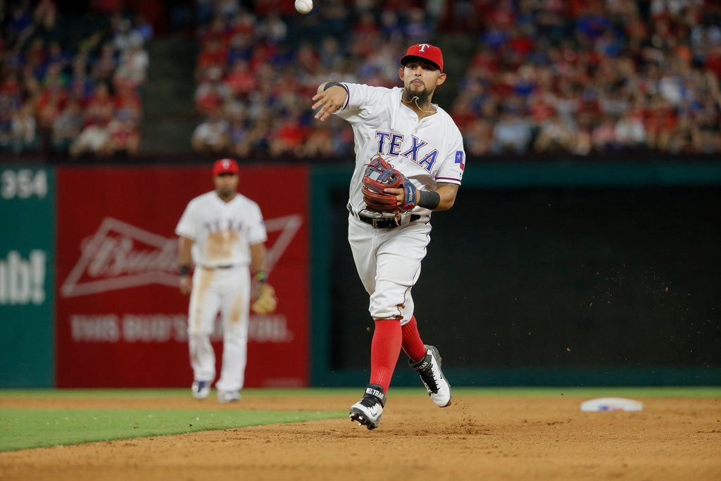 Texas Rangers second baseman Rougned Odor throws to first during a baseball game against the Los Angeles Angels on Wednesday, Sept. 21, 2016, in Arlington, Texas. (AP Photo/Tony Gutierrez)