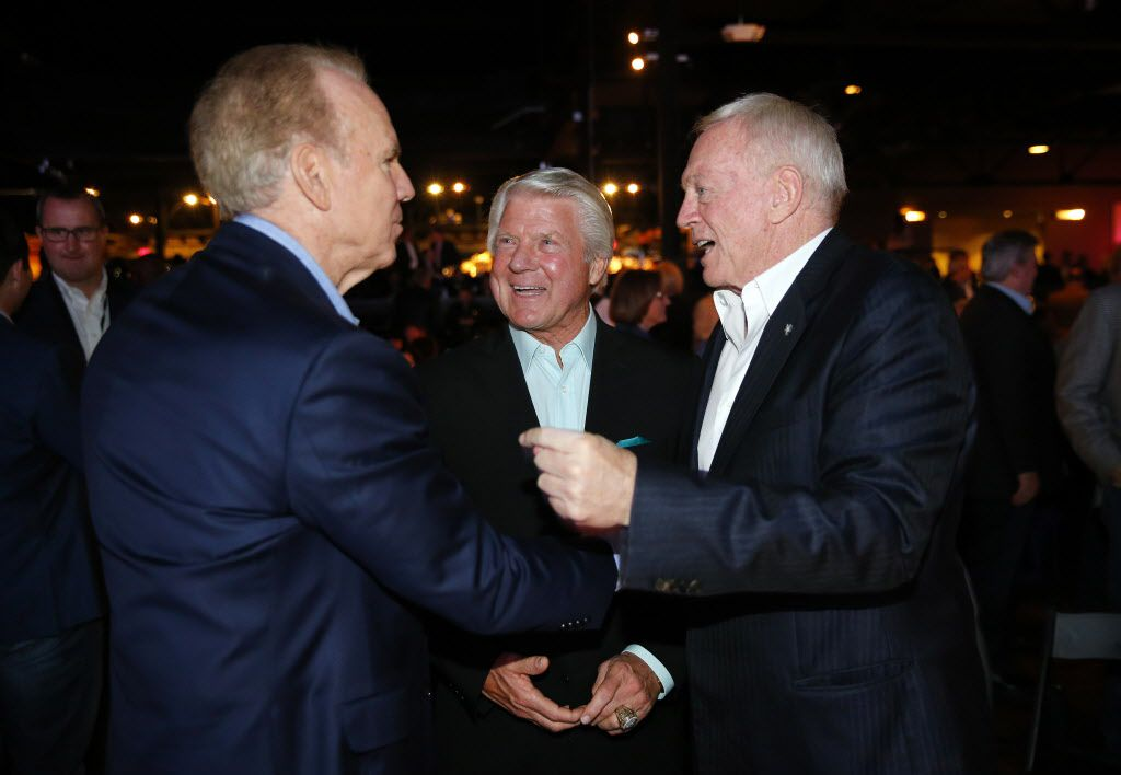 Dallas Cowboys owner Jerry Jones (right) and his former Super Bowl-winning coach Jimmy Johnson (center) greet former quarterback Roger Staubach following the 25th Anniversary of the Dallas Cowboys Super Bowl XXVII at Gilley's in Dallas, Saturday, February 25, 2017. The event was hosted by Troy Aikman and United Way of Metropolitan of Dallas in which he is the new fundraiser. The evening featured appearances by Cowboys legends, a conversation with head coach Jimmy Johnson and other members of the 1992 coaching staff, and a special celebration honoring Jerry Jones for his election to the Pro Football Hall of Fame. (Tom Fox/The Dallas Morning News)