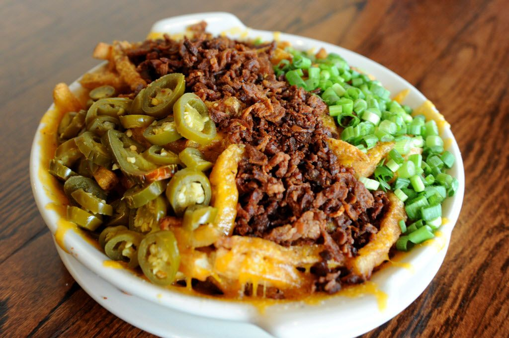 The fully loaded cheddar fries features hand-cut Idaho potato fries with aged Wisconsin cheddar cheese, jalapenos, bacon, and chives at Snuffers in Addison, TX on May 7, 2015. (Alexandra Olivia/ Special Contributor)