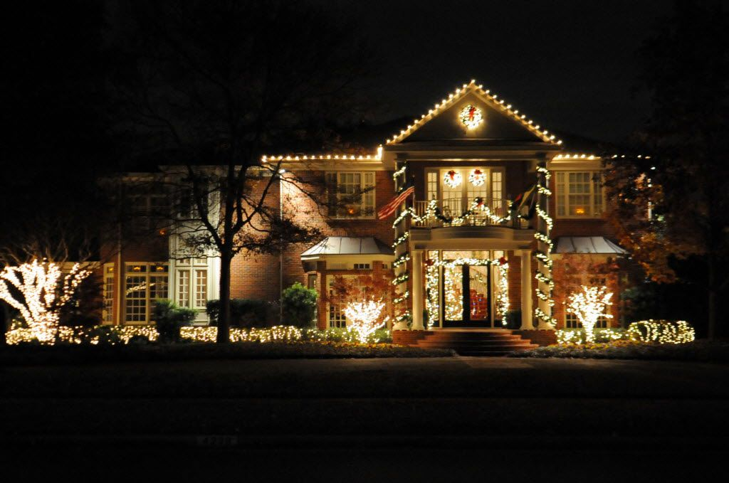 A house is classically lit with white lights and Christmas wreaths at 4230 Beverly Drive in Highland Park.
