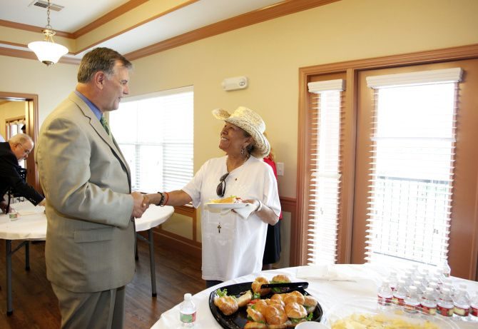 Dallas Mayor Mike Rawlings greeted future resident Rebecca Martinez after a ribbon-cutting ceremony Thursday for Renaissance Oaks, the final phase of the Dallas Housing Authority's Roseland Community redo. The 85-unit addition will house seniors and residents with disabilities.
