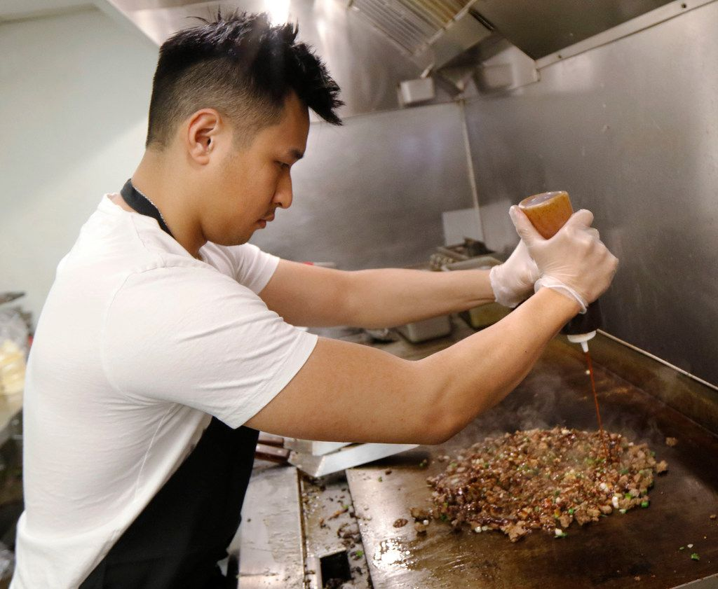 Calvin Nguyen, founder and CEO of OMG Tacos, makes OMG steak tacos, the restaurant's most popular item.