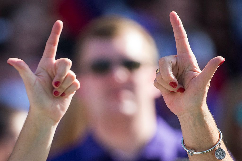 "Texas Tech fans hold ""Guns Up"" before an NCAA football game against TCU at Amon G. Carter Stadium on Saturday, Oct. 29, 2016, in Fort Worth. (Smiley N. Pool/The Dallas Morning News)"