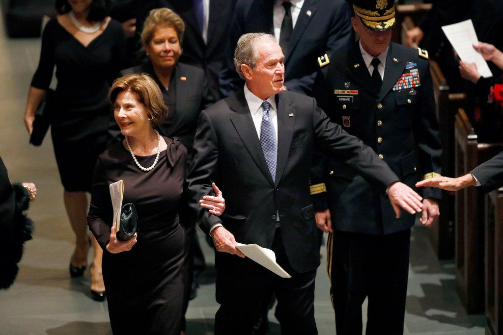 Former President George W. Bush and Laura Bush were greeted by well-wishers during the funeral recessional for George H.W. Bush at St. Martin's Episcopal Church in Houston on Thursday, Dec. 6, 2018.