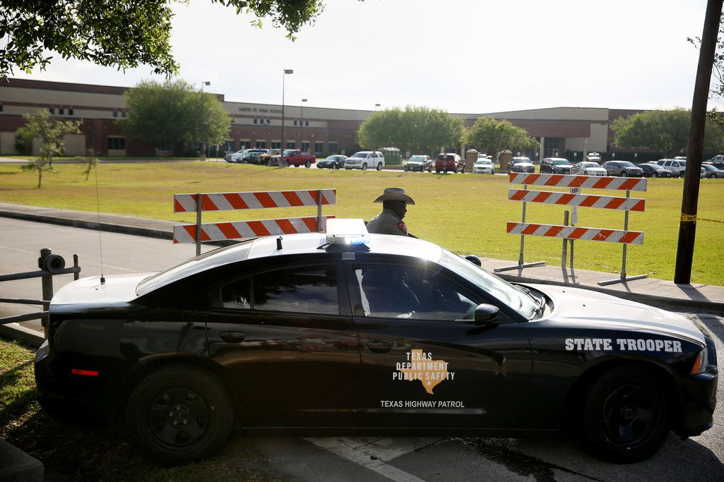 A Texas State Trooper stands outside of Santa Fe High School in Santa Fe, Texas Saturday May 19, 2018.
