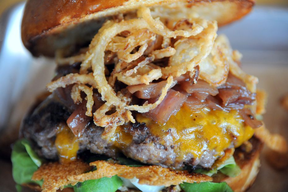 BrainDead Brewing's coma burger at comes with a house-ground brisket and bacon patty, clarified butter, stout mustard, sweet onion jam, house made beer pickles, shredded butter lettuce, tomato, smoked cheddar and crispy shallots