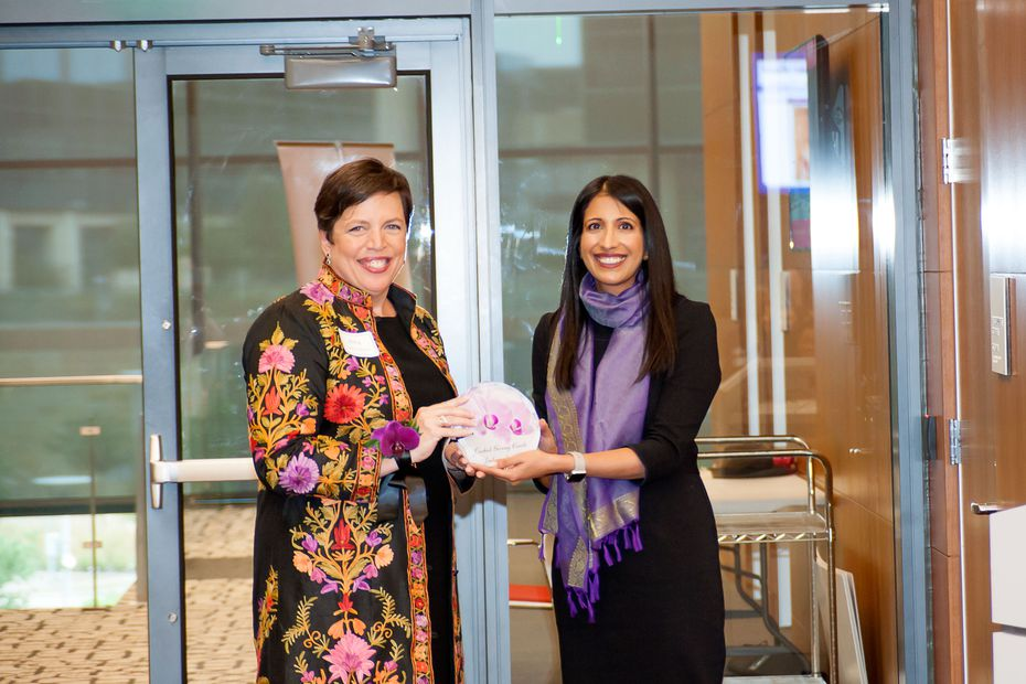 Amy Lewis Hofland receives the inaugural Orchid Giving Circle Ambassador Award from Sakina Foster. Photo by Ansel Cheng.