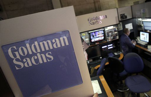 In this March 15, 2012, photo, a trader works in the Goldman Sachs booth on the floor of the New York Stock Exchange. Goldman agreed on Jan. 14 to a $5 billion settlement withe federal and state authorities over its role in the sale of mortgages in the years leading up into the housing bubble and subsequent financial crisis. (AP Photo/Richard Drew, File)