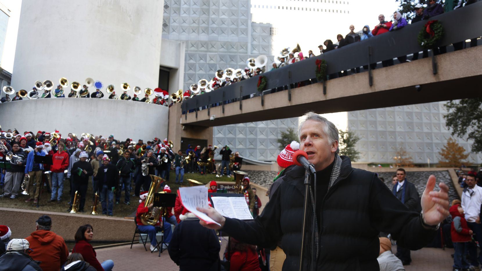Brett Shipp hosts tuba players performing together in TUBACHRISTMAS at Thanks-Giving Square.