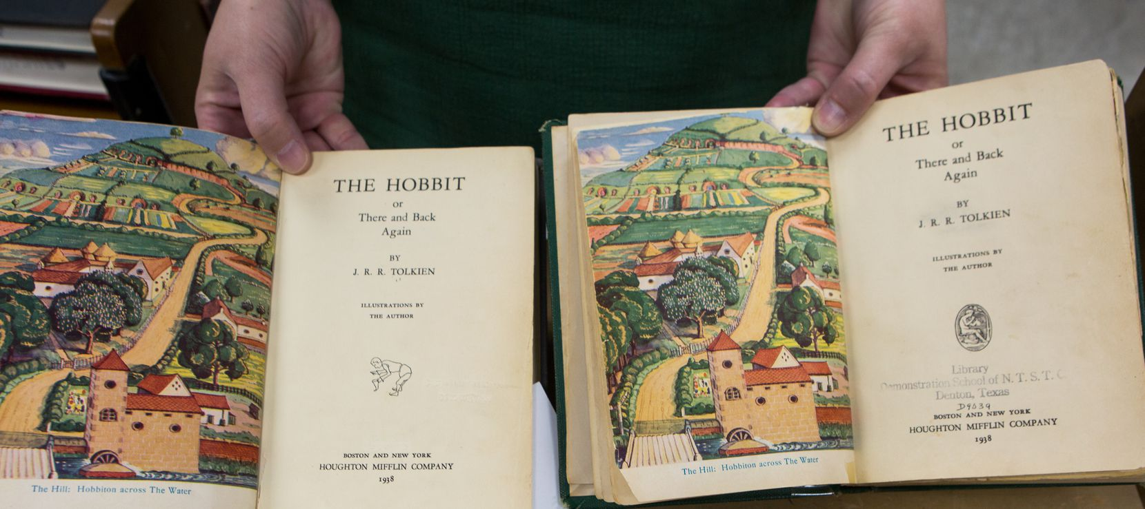 The returned first edition 1938 copy of The Hobbit by J.R.R. Tolkien (left) is also a first round print edition adding to it's value. Unique identifiers such as the hobbit illustration on the title page mark distinguish it from the first edition copy on the right. Photo taken Thursday, April 11, 2019 at the UNT library annex in Denton, Texas.