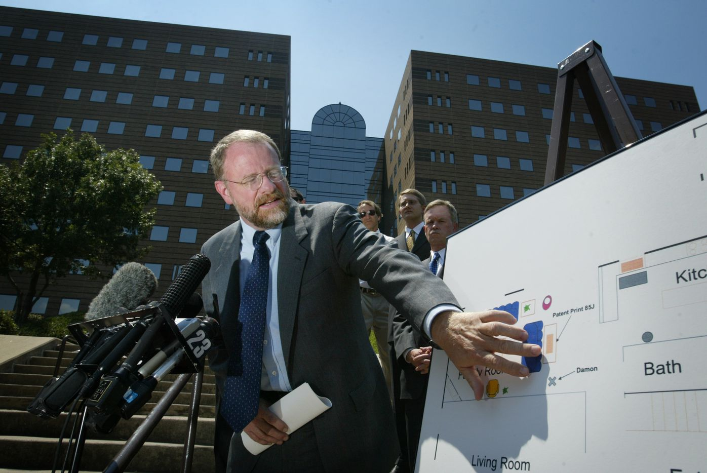 Richard Burr, one of the lawyers for Darlie Routier, shows the position of an unidentified finger print on a map of the Routier home as they talked about the latest developments in her case in 2004. A state district court refused to to examine evidence that they believe points to her innocence.  The news conference was held  in front of the Frank Crowley Courts Building  in Dallas.