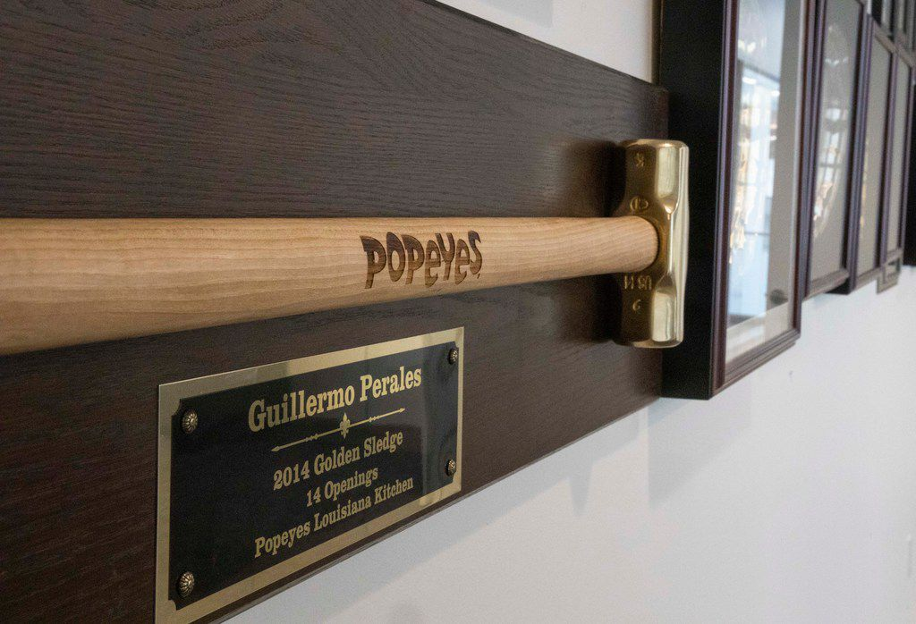 A Golden Sledge hangs on the wall along with Guillermo Perales' other awards at Sun Holdings Inc. in Dallas.
