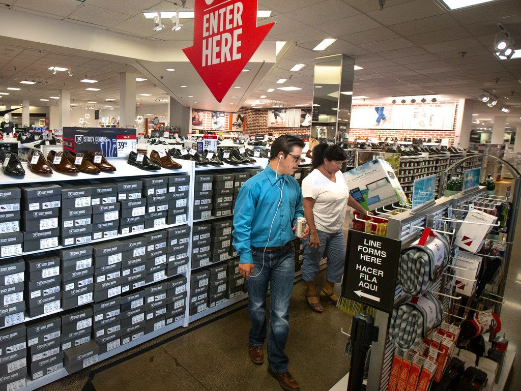Anyone can shop tax free Aug 9-11 in Texas on apparel and shoes that cost under $100.  Jacob Tyler (left) and Liza Zavala shop at the J.C. Penney located in the former Collin Creek Mall in Plano.