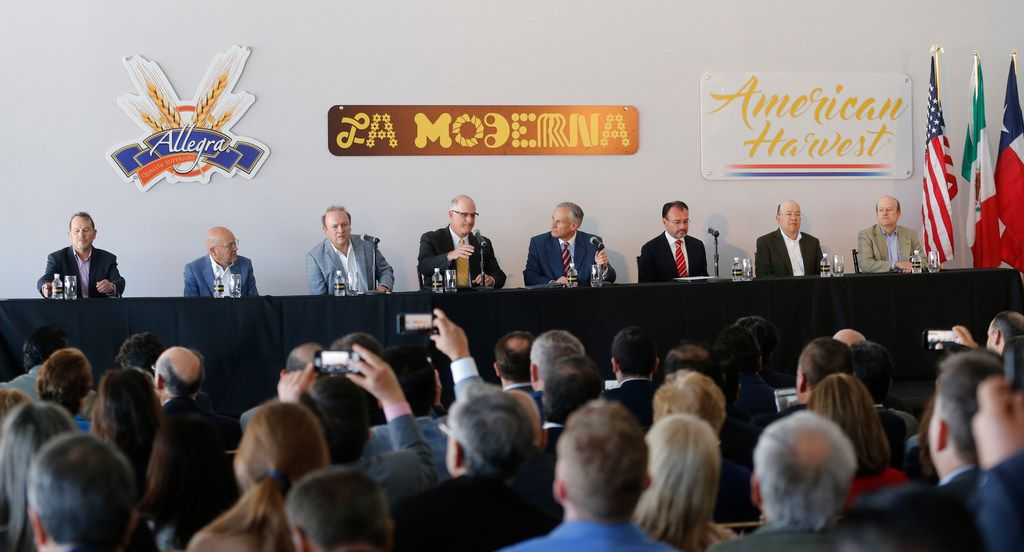 Gov. Greg Abbott (fourth from right) was among the dignitaries who attended the opening of a La Moderna pasta factory in Cleburne on March 20.