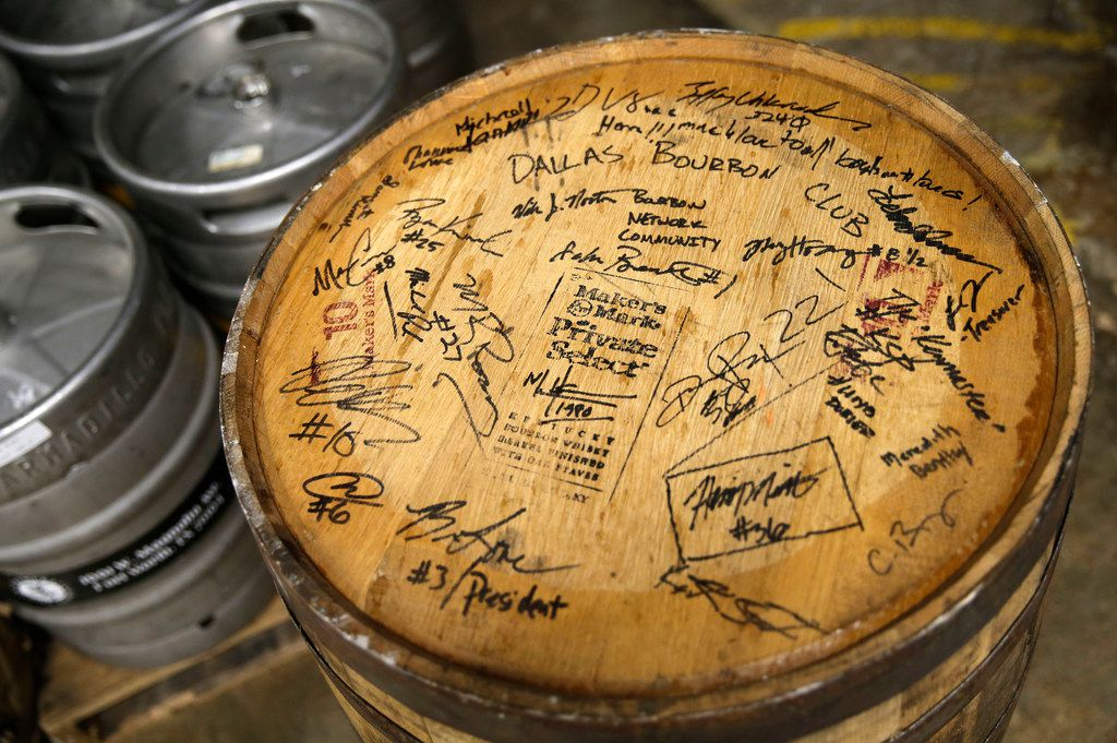 Detail of the Dallas Bourbon Club signed barrel of Maker's Mark Private Select used to make Meteor Maker at Celestial Beerworks in Dallas, on Friday, May 24, 2019. Dallas Bourbon Club teamed up with Celestial Beerworks by getting Celestial Beerworks to age a beer in a Maker's Mark wooden barrel for Meteor Maker. Meteor Maker, a Maker's Mark Private Select barrel-aged imperial stout brewed with vanilla, lactose and coffee. (Vernon Bryant/The Dallas Morning News)