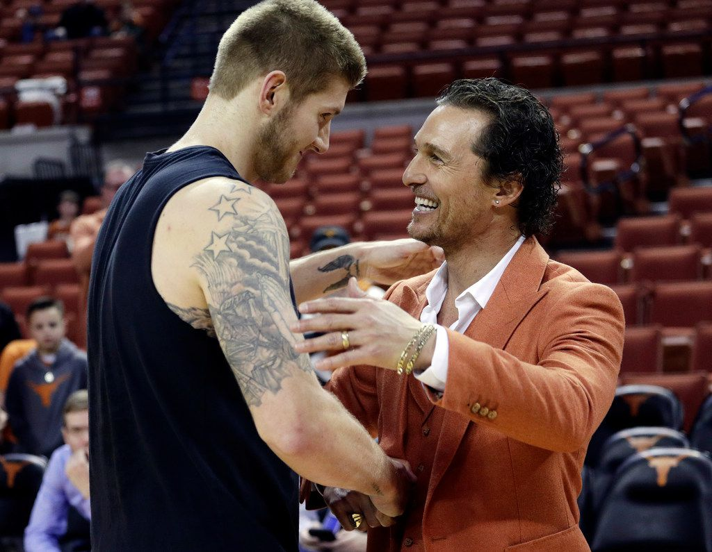 Actor Matthew McConaughey, right, visits with Texas forward Dylan Osetkowski before the team's NCAA college basketball game against Oklahoma in Austin, Texas, Saturday, Jan. 19, 2019. (AP Photo/Eric Gay)