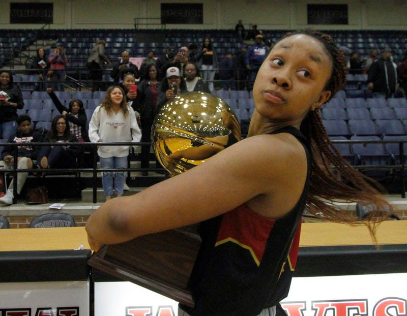 South Grand Prairie forward Camryn Hill (12) glances over her shoulder but not until after the Warriors defeated Duncanville 71-60 to capture the Bi-District trophy and to punch their ticket to advance in the playoffs. The two teams played their Class 6A bi-district girls basketball playoff game at Mansfield Timberview High School in Arlington on February 12, 2019. (Steve Hamm/ Special Contributor)