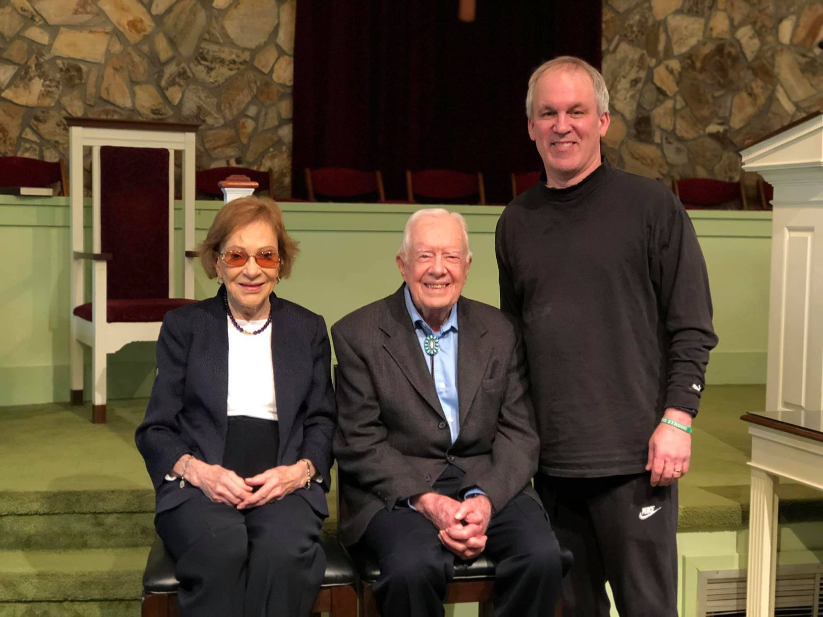 The author poses for a photo after the 11 a.m. church service with Rosalynn Carter and President Jimmy Carter.
