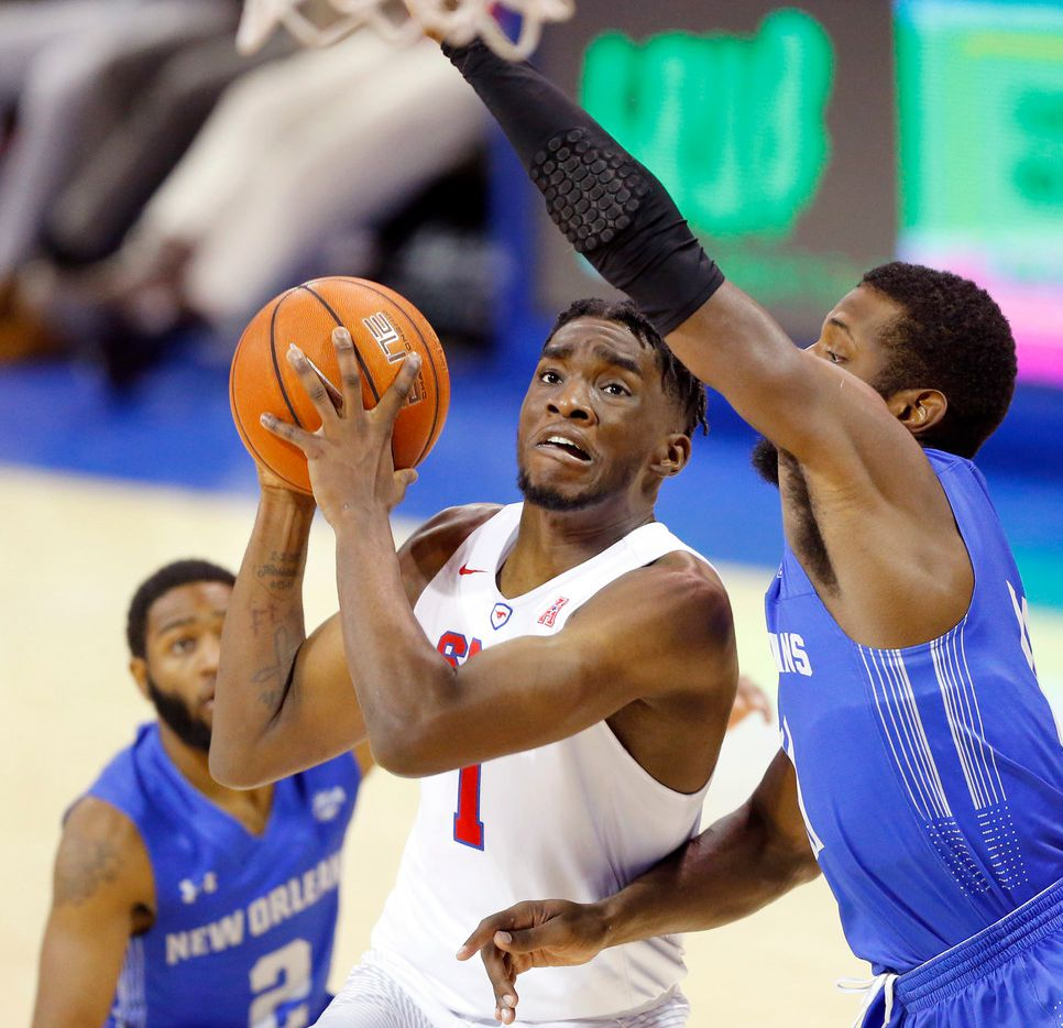 Southern Methodist Mustangs guard Shake Milton (1) puts up a driving shot past New Orleans Privateers guard Michael Zeno (11) in the second half at Moody Coliseum on the SMU campus in University Park, Texas, Wednesday, December 14, 2017. The Mustangs won, 79-66. (Tom Fox/The Dallas Morning News)