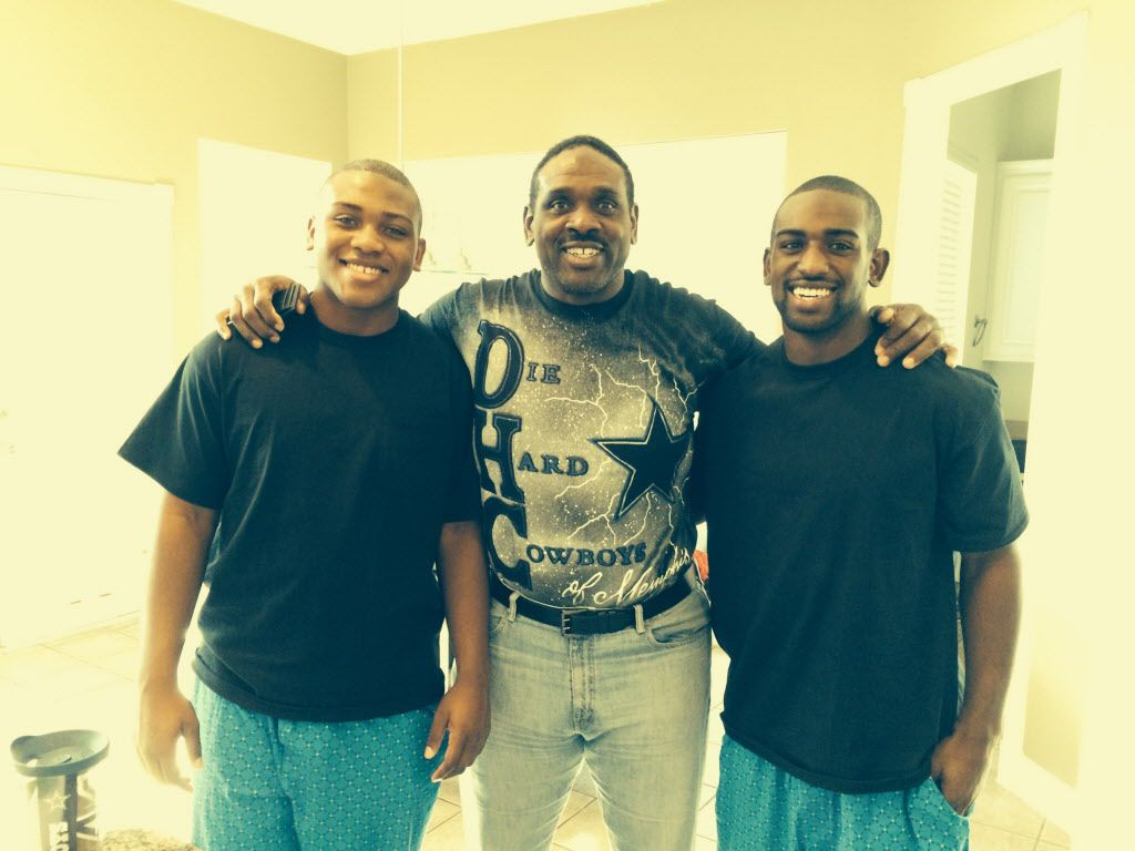 Former Cowboys player Nate Newton with his sons King (left) and Tre'.