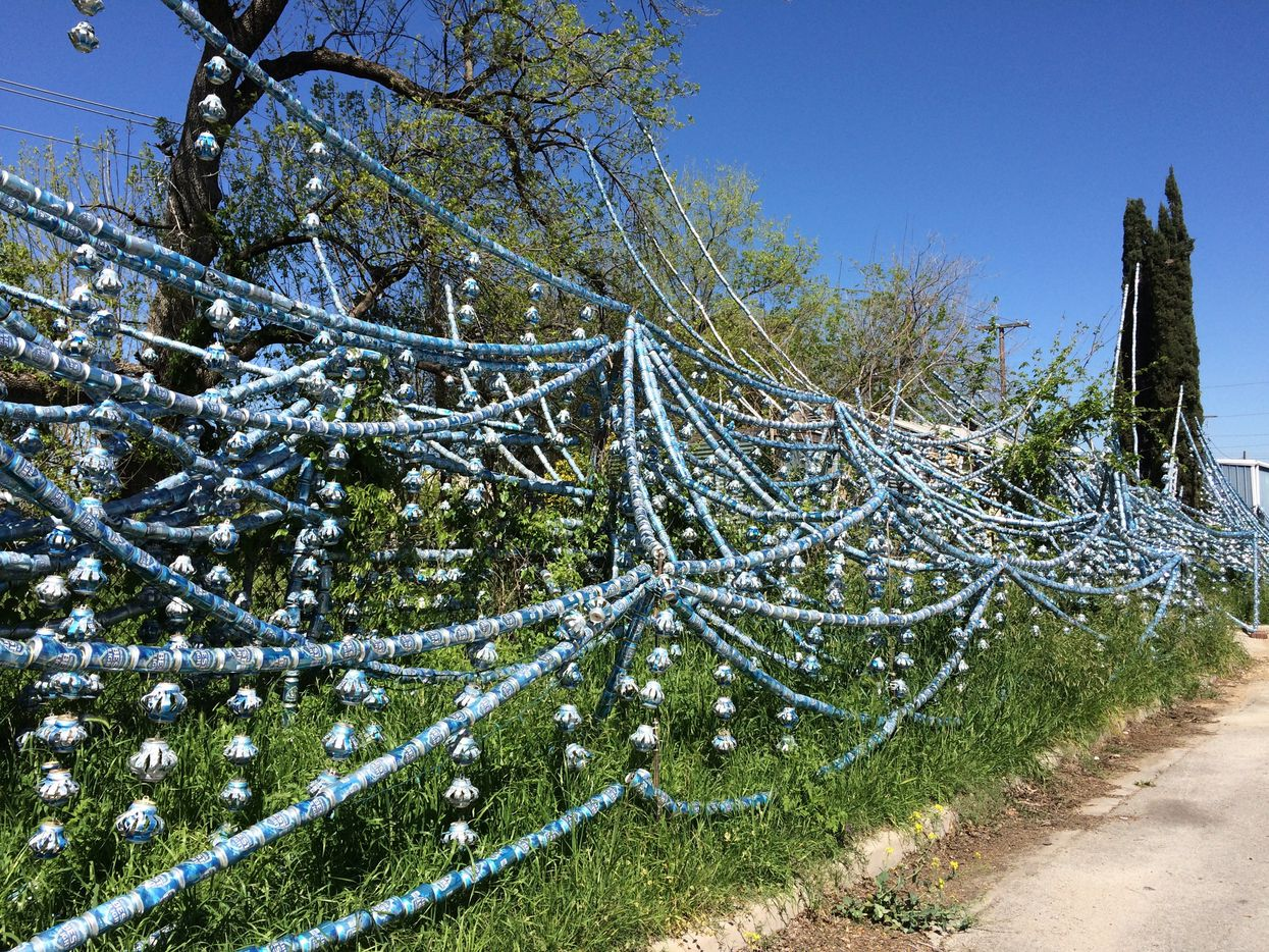 Resident Louis Torres estimates there are 2,000 beer cans decorating the outside of his home in Fort Worth.